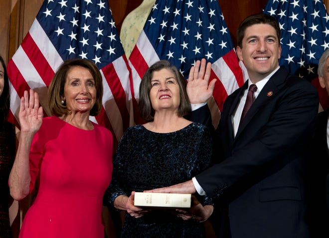 Speaker Nancy Pelosi (left) administers the House oath of office to Rep. Bryan Steil, R-Wis., during the ceremonial swearing-in on Capitol Hill in Washington during the opening session of the 116th Congress.