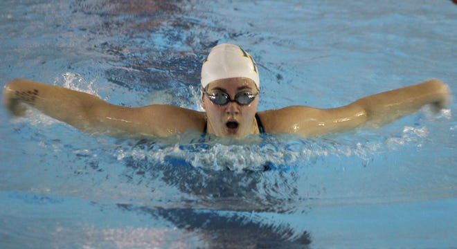 Mountain Home's Brandy Martineau competes in a butterfly event on Thursday at Pocahontas.