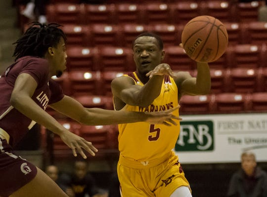 Texas State held guard Daishon Smith (5) to nine points, but ULM had four players in double figures in Thursday night's 63-60 win. Forward Travis Munnings and guard Michael Ertel each scored a team-high 13 points, while guard J.D. Williams had 11 points and forward Andre Washington 10 points.