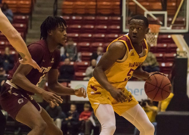 University of Louisiana at Monroe's Daishon Smith (5) surveys his options for moving the ball while being guarded by Little Rock University's Horace Wyatt Jr. (25) during the game at Fant-Ewing Coliseum in Monroe, La. on Jan. 3.