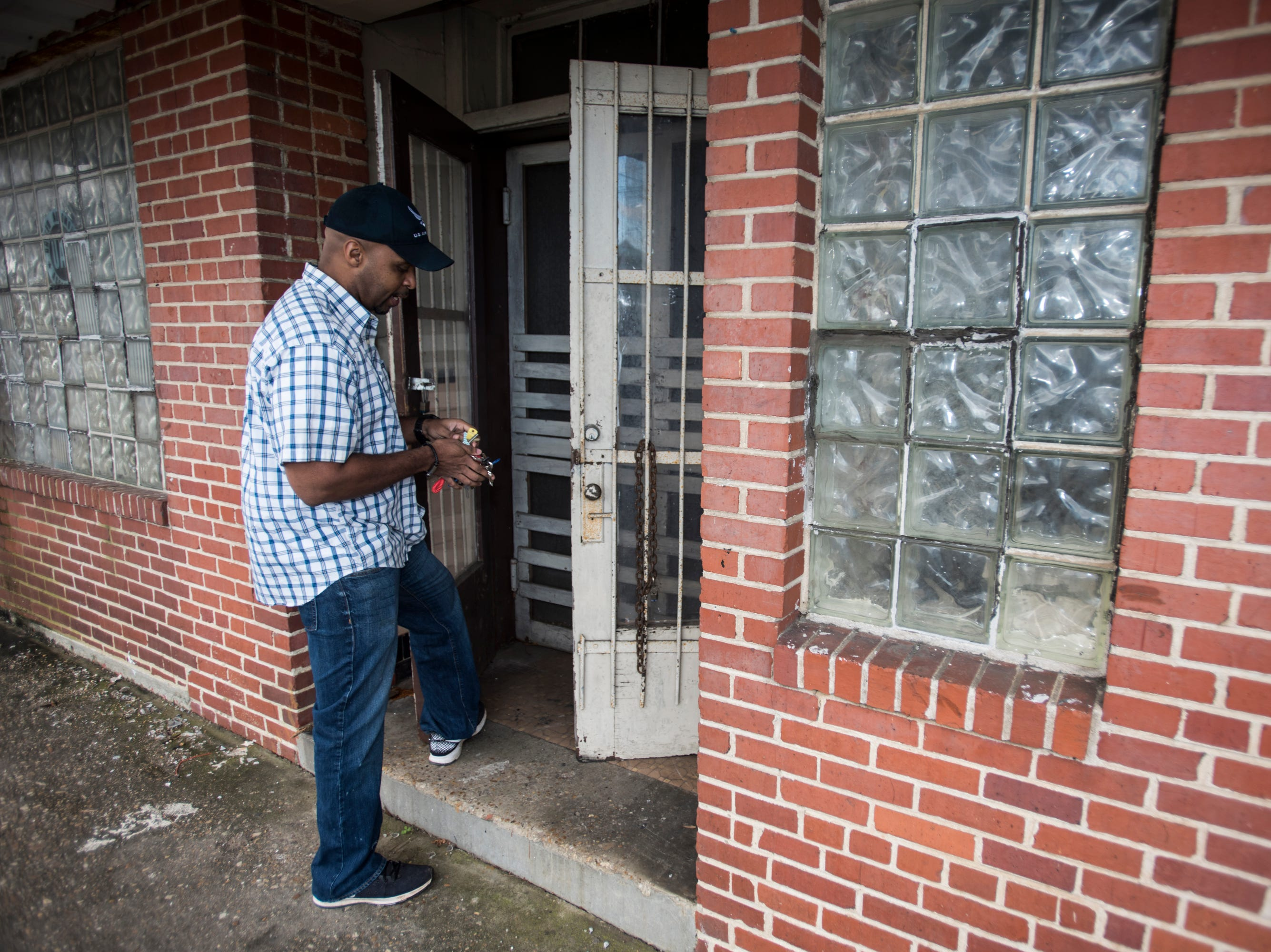 Owner Edward Davis locks up the doors at the Ben Moore Hotel in Montgomery, Ala., on Friday, Jan. 4, 2019.