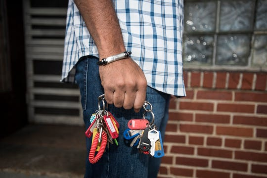 Owner Edward Davis holds his keys outside the Ben Moore Hotel in Montgomery, Ala., on Friday, Jan. 4, 2019.