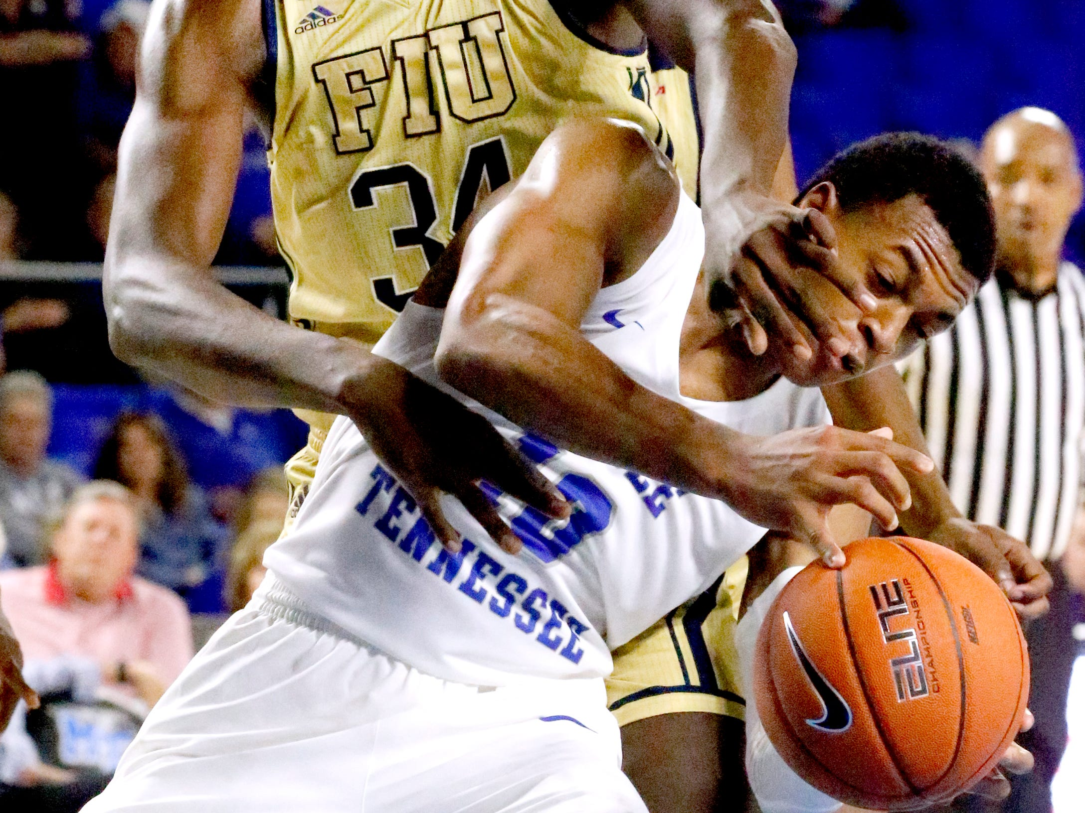 MTSU's guard Jayce Johnson (10) goes up for a shot as he is fouled y FIU's forward Osasumwen Osaghae (34) on Thursday Jan. 3, 2019, at MTSU.