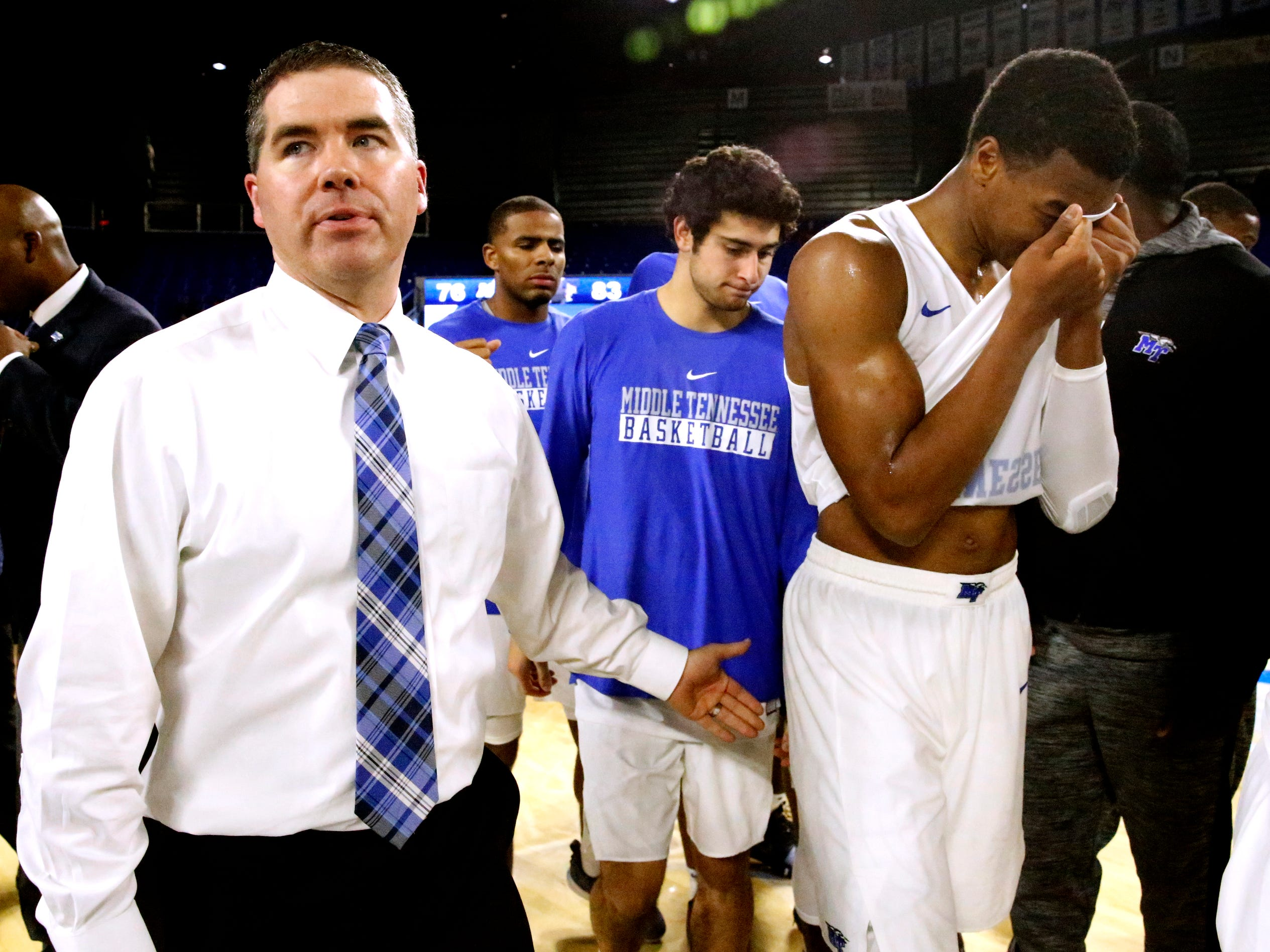 MTSU's head coach Nick McDevitt meets with his team on the court after the lost to FIU 83-76, which was the team's 10th loss in a row on Thursday Jan. 3, 2019, at MTSU. MTSU's guard Jayce Johnson (10) wipes hi face after the game.