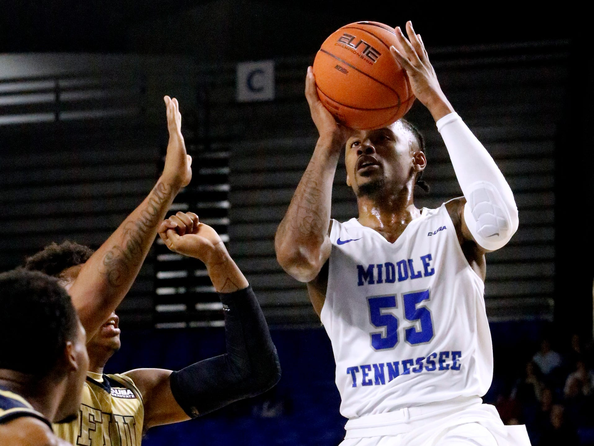 MTSU's guard Antonio Green (55) goes up for a shot as FIU's forward Michael Douglas (31) guards him on Thursday Jan. 3, 2019, at MTSU.