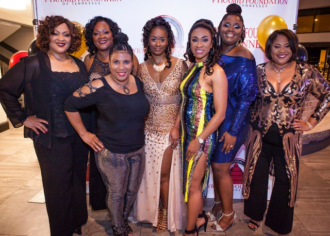 Hope Oliver, Carolyn Cox, Shalita Simmons, Lashonda Greenwood, Charlene Montrose, Kenya Adams and Renee Rachell at the Pyramid Foundation's Shimmer and Shine New Year's Eve party, held at DoubleTree Hotel in Murfreesboro.