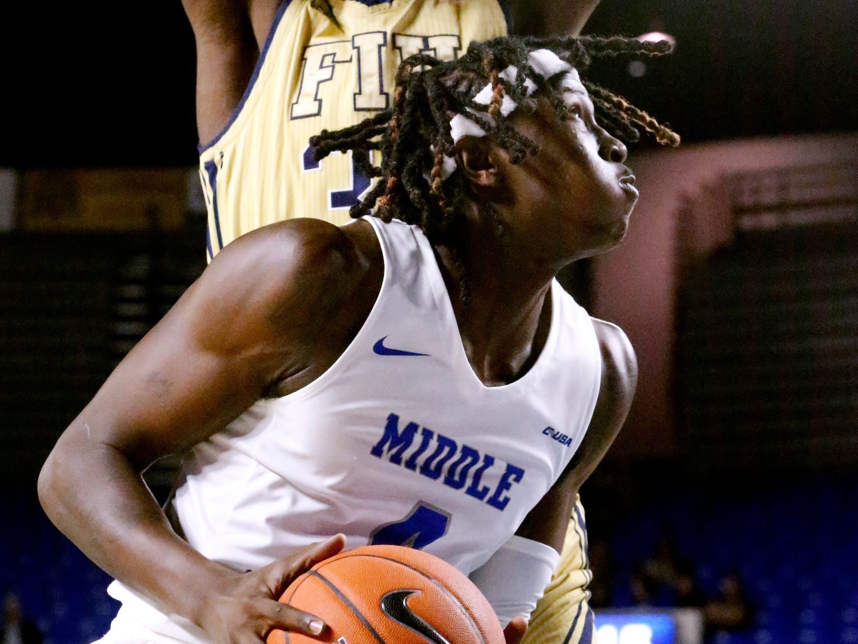 MTSU's forward James Hawthorne (4) goes up for a shot as FIU's forward Osasumwen Osaghae (34) defends the goal on Thursday Jan. 3, 2019, at MTSU.