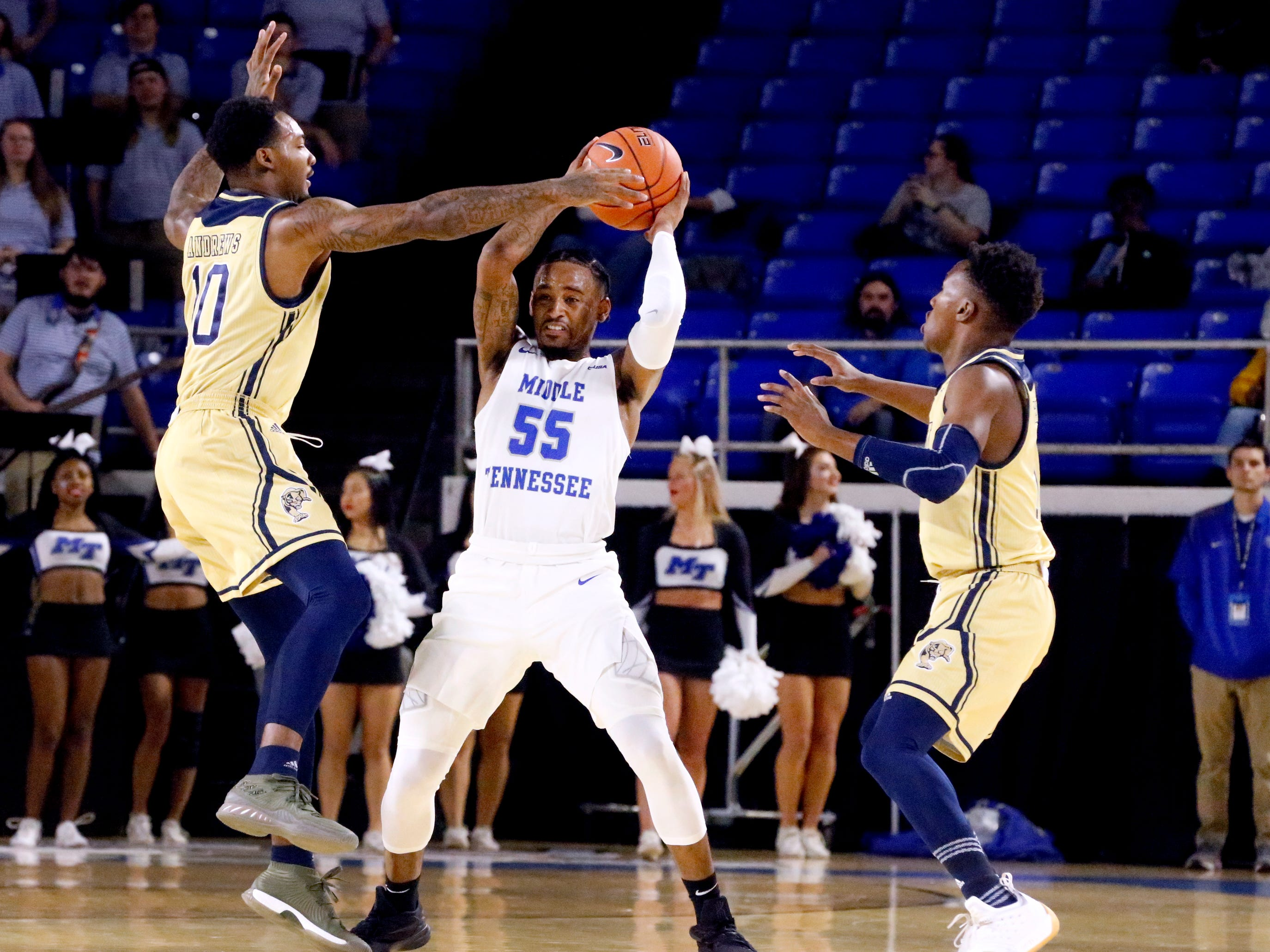 MTSU's guard Antonio Green (55) brings the ball down the court as he is guarded by FIU's guard Willy Nunez Jr. (20) and FIU's guard Marcus Burwell (11) on Thursday Jan. 3, 2019, at MTSU.