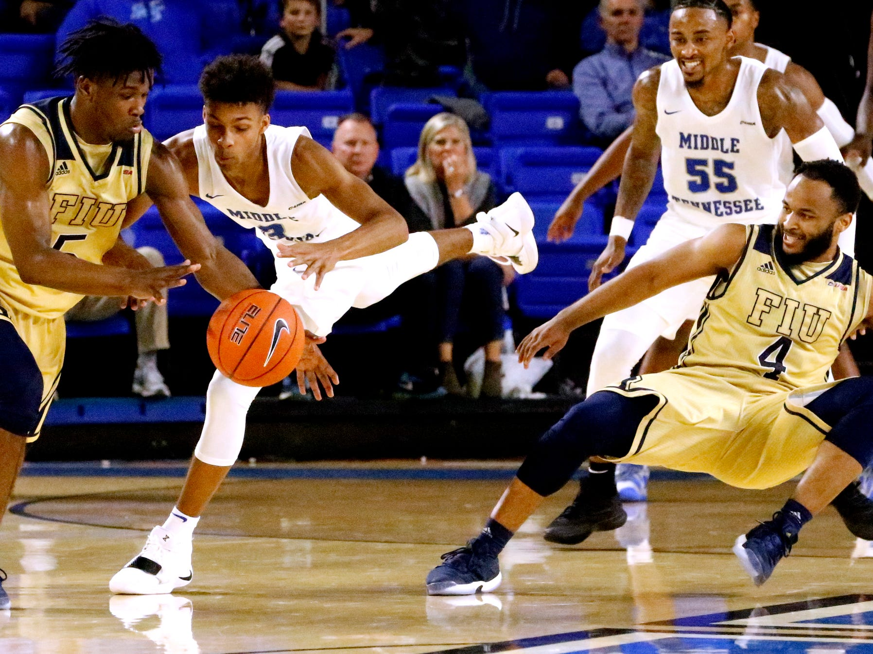 MTSU's guard Donovan Sims (3) steals the ball away rom FIU's guard Brian Beard Jr. (4) only to have it re stolen by FIU's guard Antonio Daye Jr. (5) on Thursday Jan. 3, 2019, at MTSU.