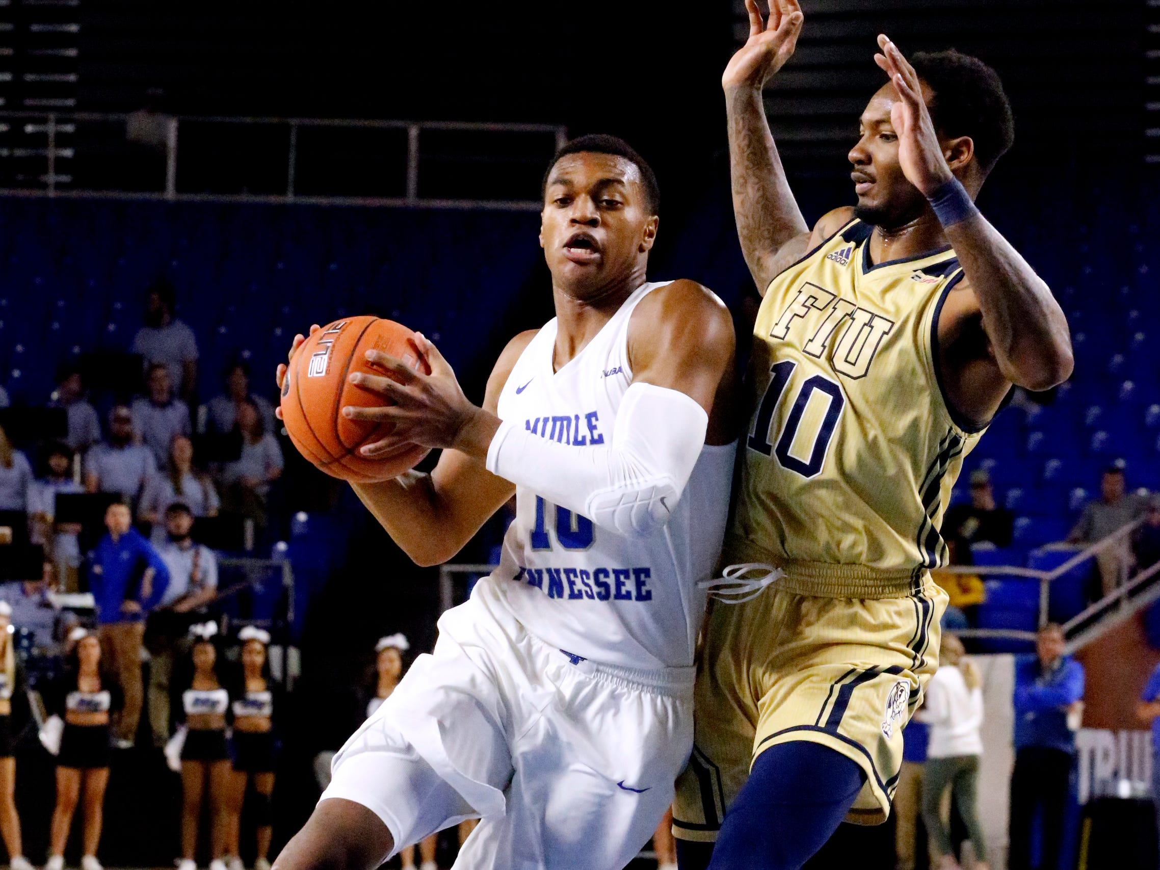 MTSU's guard Jayce Johnson (10) approaches the basket as FIU's forward Devon Andrews (10) defends him on Thursday Jan. 3, 2019, at MTSU.