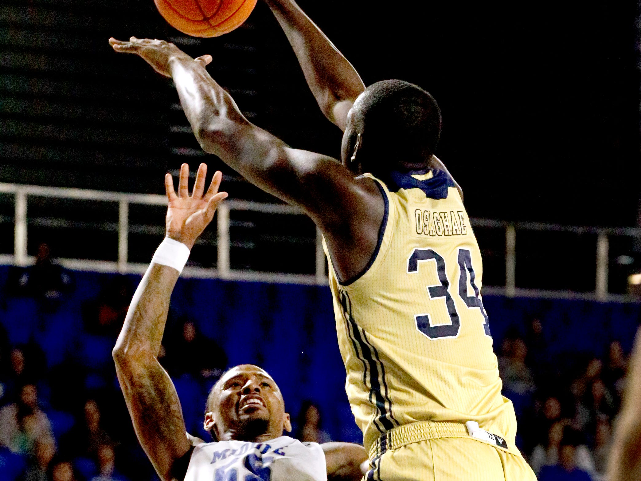 MTSU's guard Antonio Green (55) goes up for a shot as he is fouled by FIU's forward Osasumwen Osaghae (34) on Thursday Jan. 3, 2019, at MTSU.