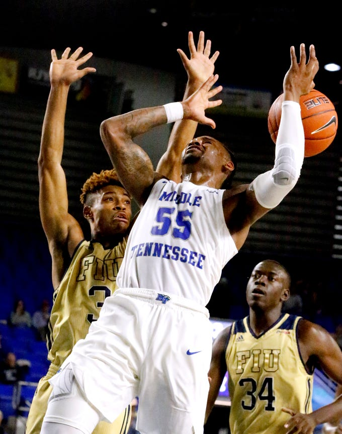 MTSU's guard Antonio Green (55) looses the ball as he goes up for a shot s FIU's guard Trejon Jacob (3) guards him on Thursday Jan. 3, 2019, at MTSU.