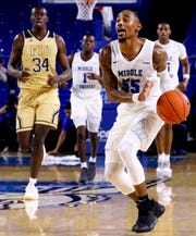 MTSU's guard Antonio Green (55) brings the ball down the court during the game against FIU on Thursday Jan. 3, 2019, at MTSU.