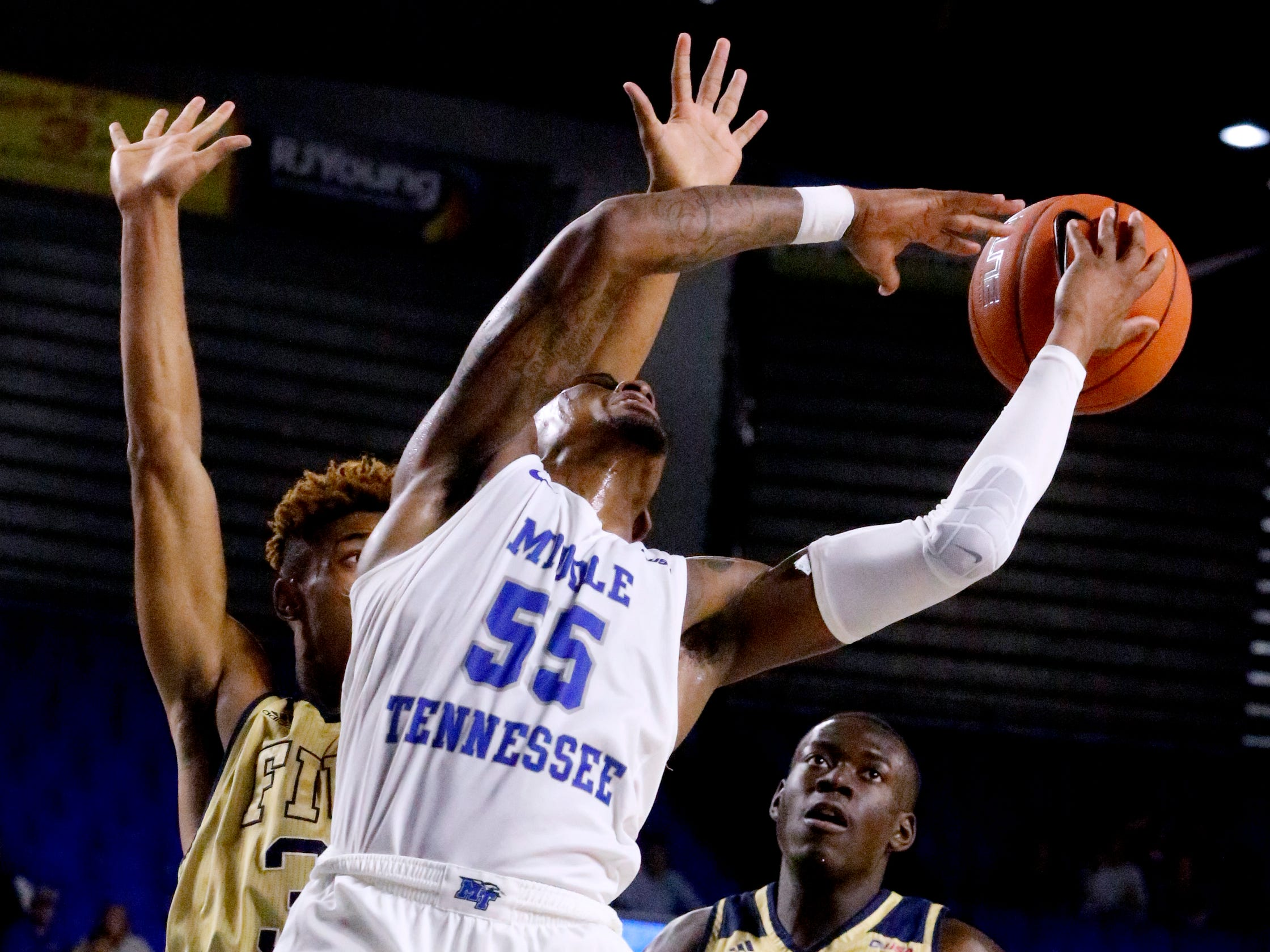 MTSU's guard Antonio Green (55) tries to grab the ball back after he looses it while going up for a shot s FIU's guard Trejon Jacob (3) guards him on Thursday Jan. 3, 2019, at MTSU.
