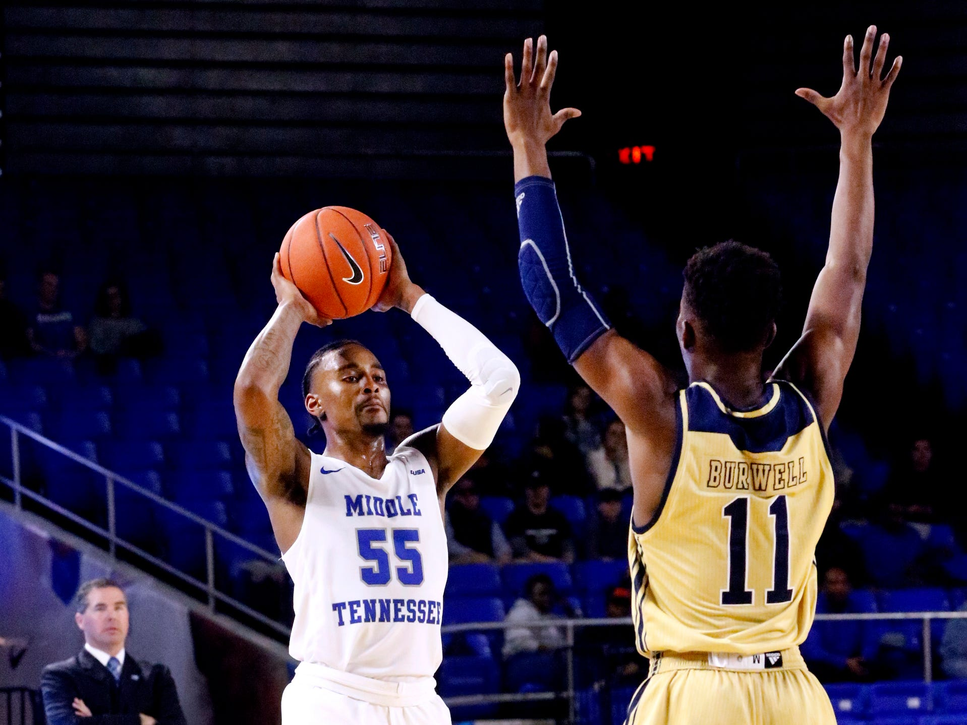 MTSU's guard Antonio Green (55) goes or a shot as FIU's guard Marcus Burwell (11) guards him on Thursday Jan. 3, 2019, at MTSU.