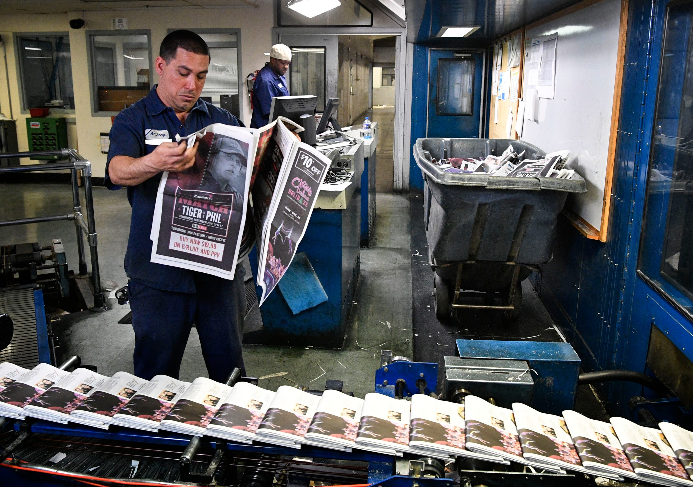 Anthony Felder checks Tennessean's Thanksgiving editions as they come off the press Wednesday, Nov. 21, 2018, in Nashville, Tenn.