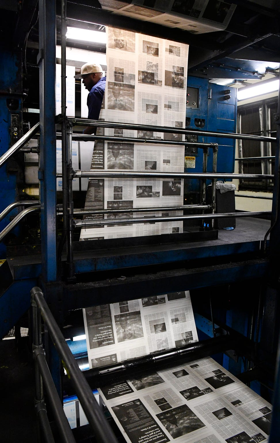 Sam White puts on printing plates as the Tennessean pressmen print the Thanksgiving Day paper Wednesday, Nov. 21, 2018, in Nashville, Tenn.