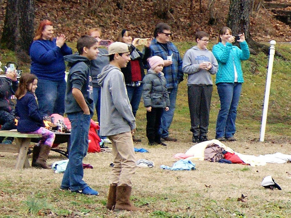 Less brave souls enjoy watching others plunge into the Whippoorwill Camp pond for the 8th Annual Fernvale Plunge on Jan. 1, 2019.