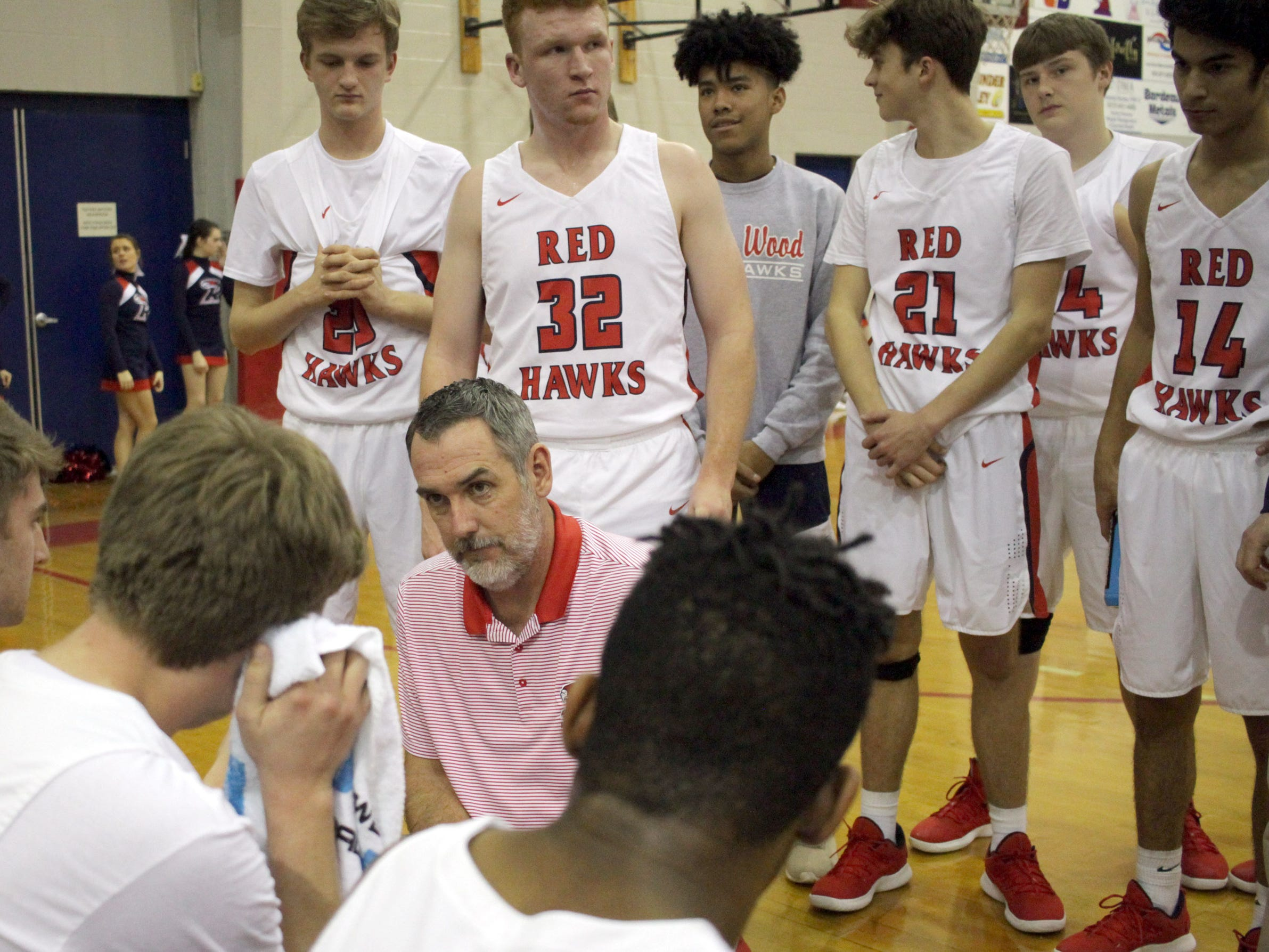 Creek Wood boys basketball coach Charles Taylor talks with his team as it hosts Sycamore on Thursday, January 3, 2019.