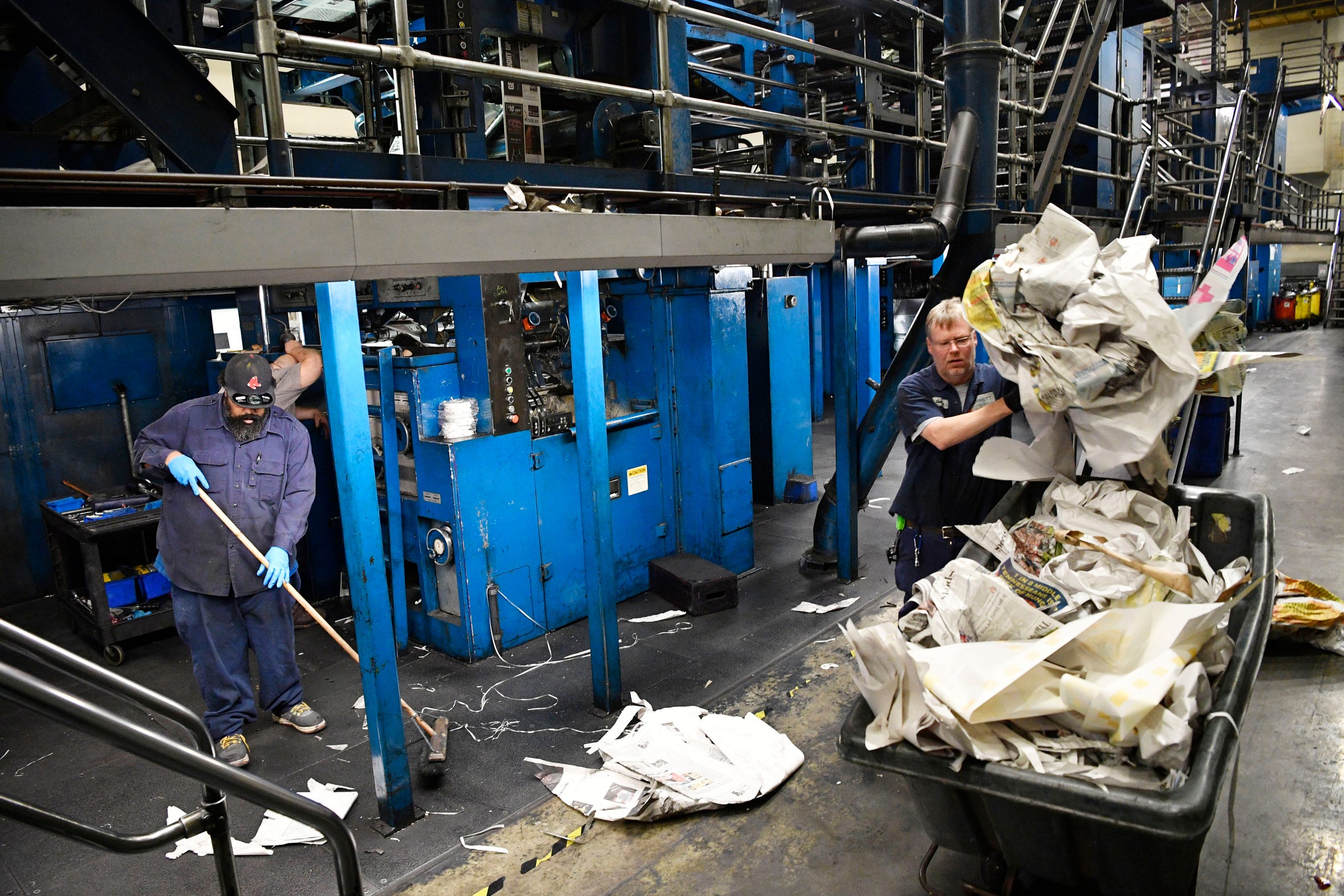 Tennessean pressmen clean up after printing the Thanksgiving Day paper Wednesday, Nov. 21, 2018, in Nashville, Tenn.