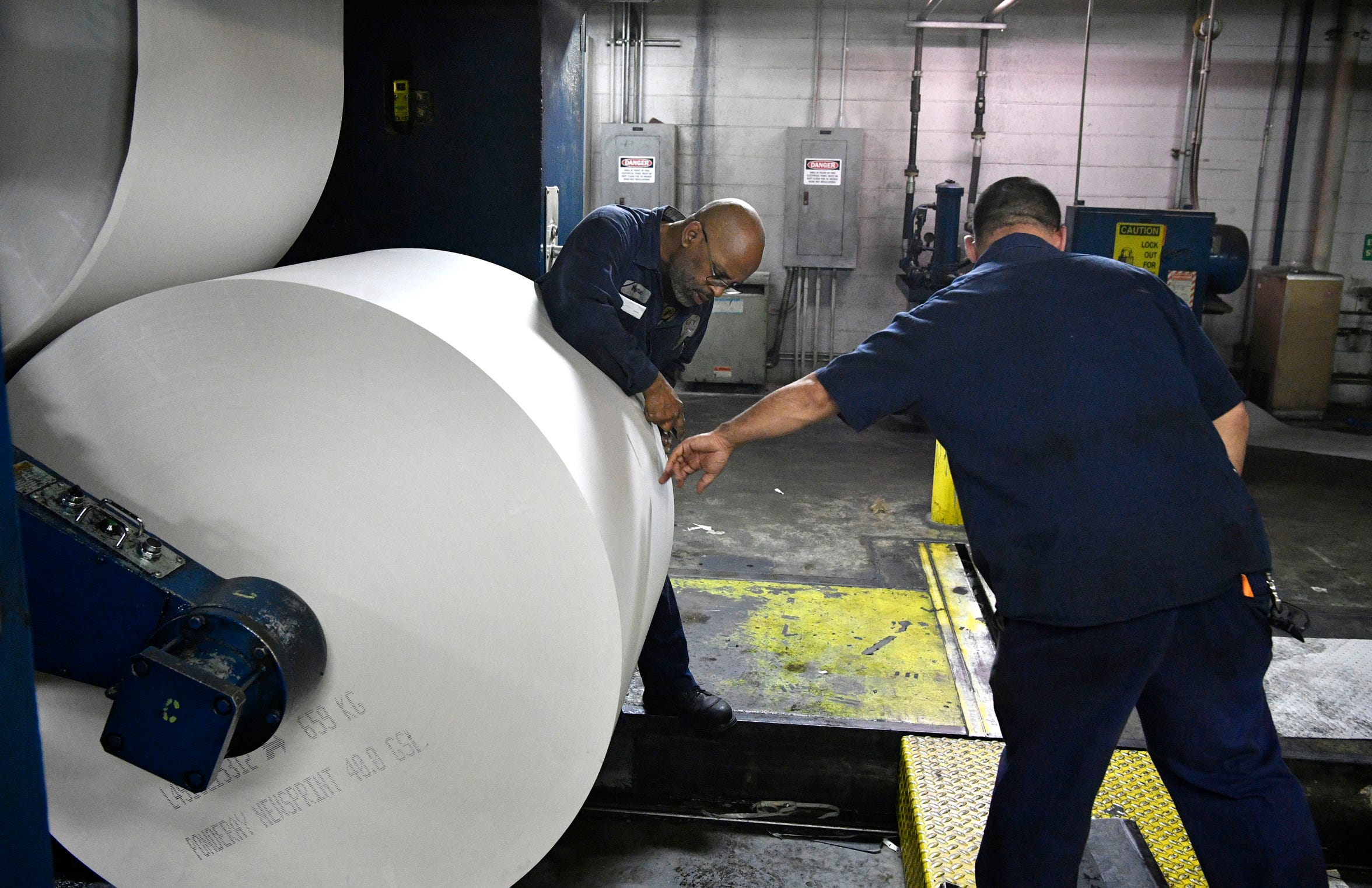 Wayne Dale installs a new roll of newsprint as the Tennessean pressmen print the Thanksgiving Day paper Wednesday, Nov. 21, 2018, in Nashville, Tenn.