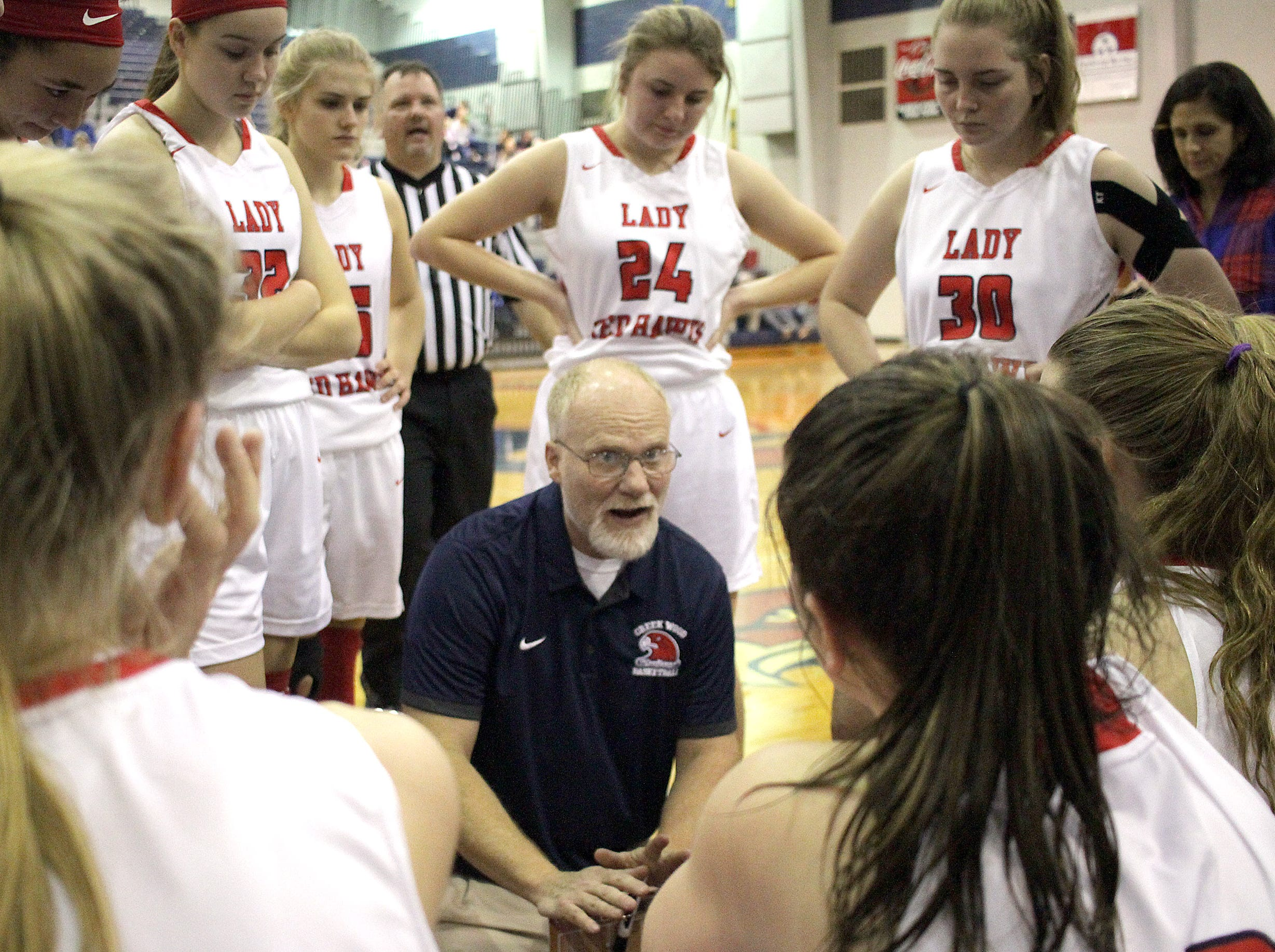 Creek Wood girls coach Russell Wllson talks with his team as they play Sycamore on Thursday, January 3, 2019.