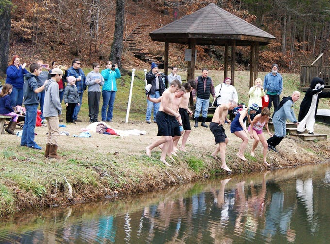 Taking the plunge into the Whippoorwill Camp pond for the 8th Annual Fernvale Plunge on Jan. 1, 2019.