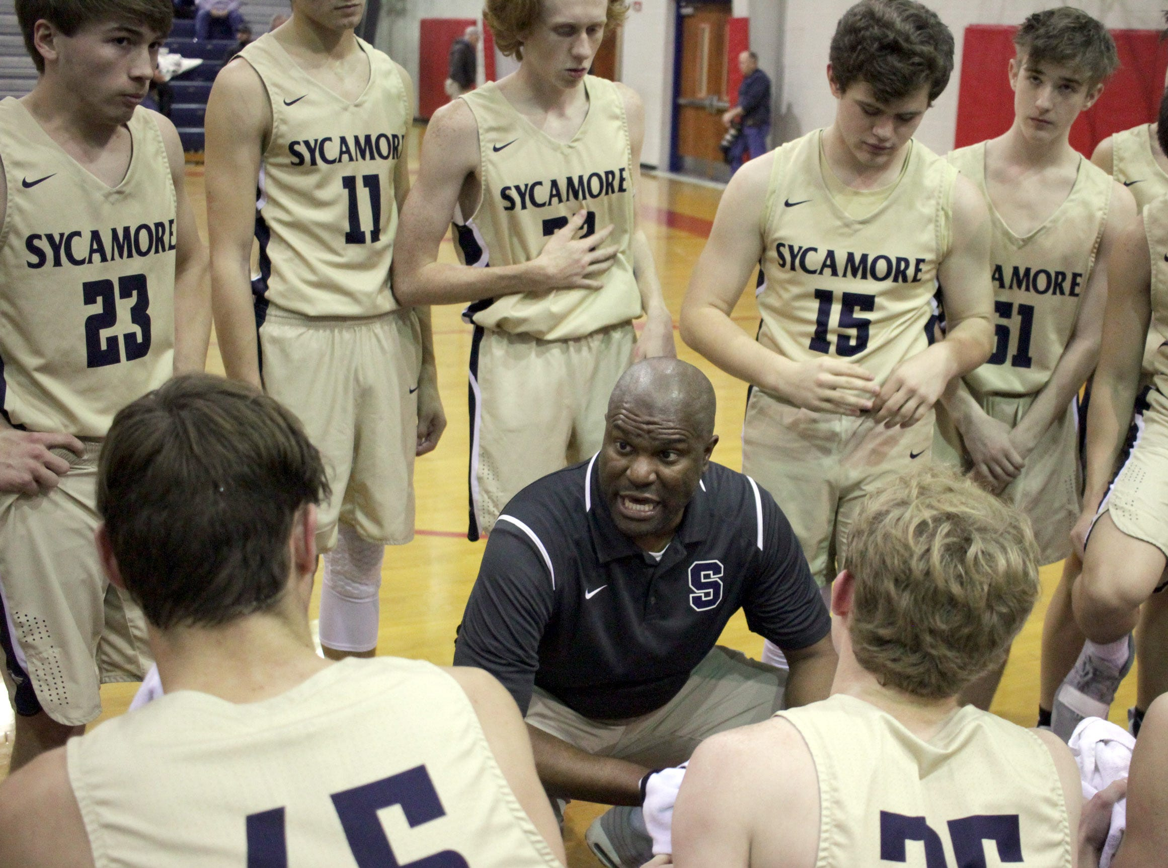 Sycamore boys basketball coach Toby Miles talks with his team as they play Creek Wood on Thursday, January 3, 2019.