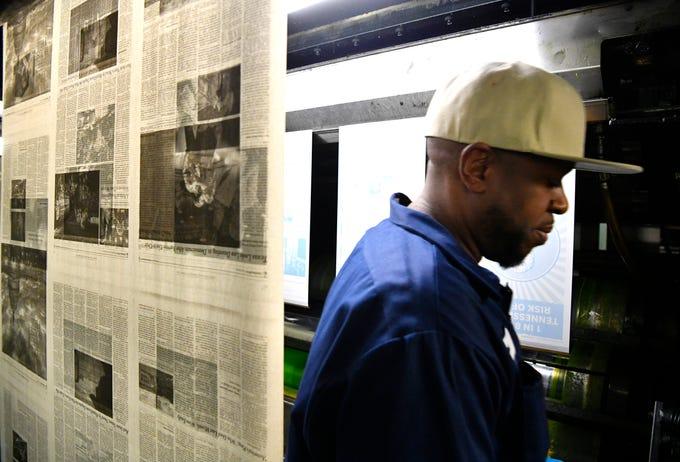 Sam White put on printing plates as the Tennessean pressmen print the Thanksgiving Day paper Wednesday, Nov. 21, 2018, in Nashville, Tenn.