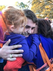 Clemson football player Seth Penner, a graduate of First Baptist Academy in Naples, hugs his mom and niece this season during Tiger Walk -- the team's walk to the stadium for each game.