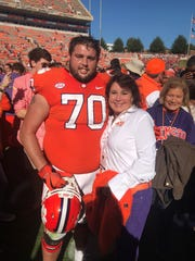 Clemson football Seth Penner poses with his mother, Jeanne, after a game this season. A graduate of First Baptist Academy in Naples, Penner is a senior with the team this season.