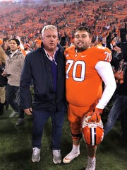 Seth Penner, a senior on the Clemson football team and graduate of First Baptist Academy in Naples, poses with his dad, Brian, after a game this season.