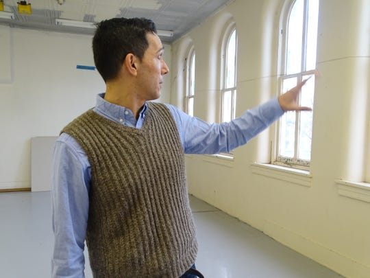 Anton Sarossy-Christon, founder of the Newark Cultural Arts Center, shows what class the room, which overlooks the courthouse, will be used for on Friday, Jan. 4, 2019.