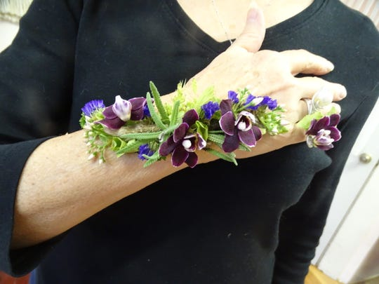 Evelyn Frolking, an instructor at the Newark Cultural Arts Center, shows an example of the floral tattoos she'll be teaching students to make during her workshops.