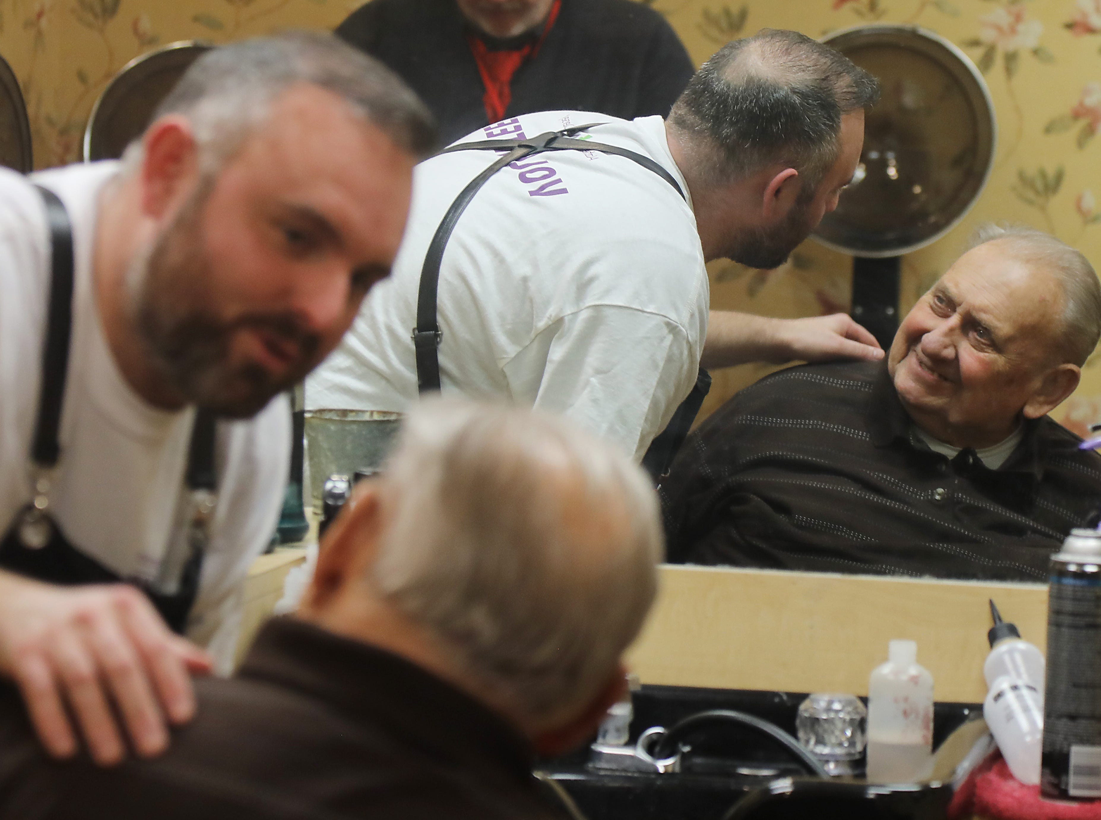 Lenny White, a barber from Northern Ireland, gives a complimentary haircut to Leroy Whitman, 89.  Whitman is a resident of The Chelsea of Montville, an assisted living facility in Montville Twp., NJ on January 3, 2019.