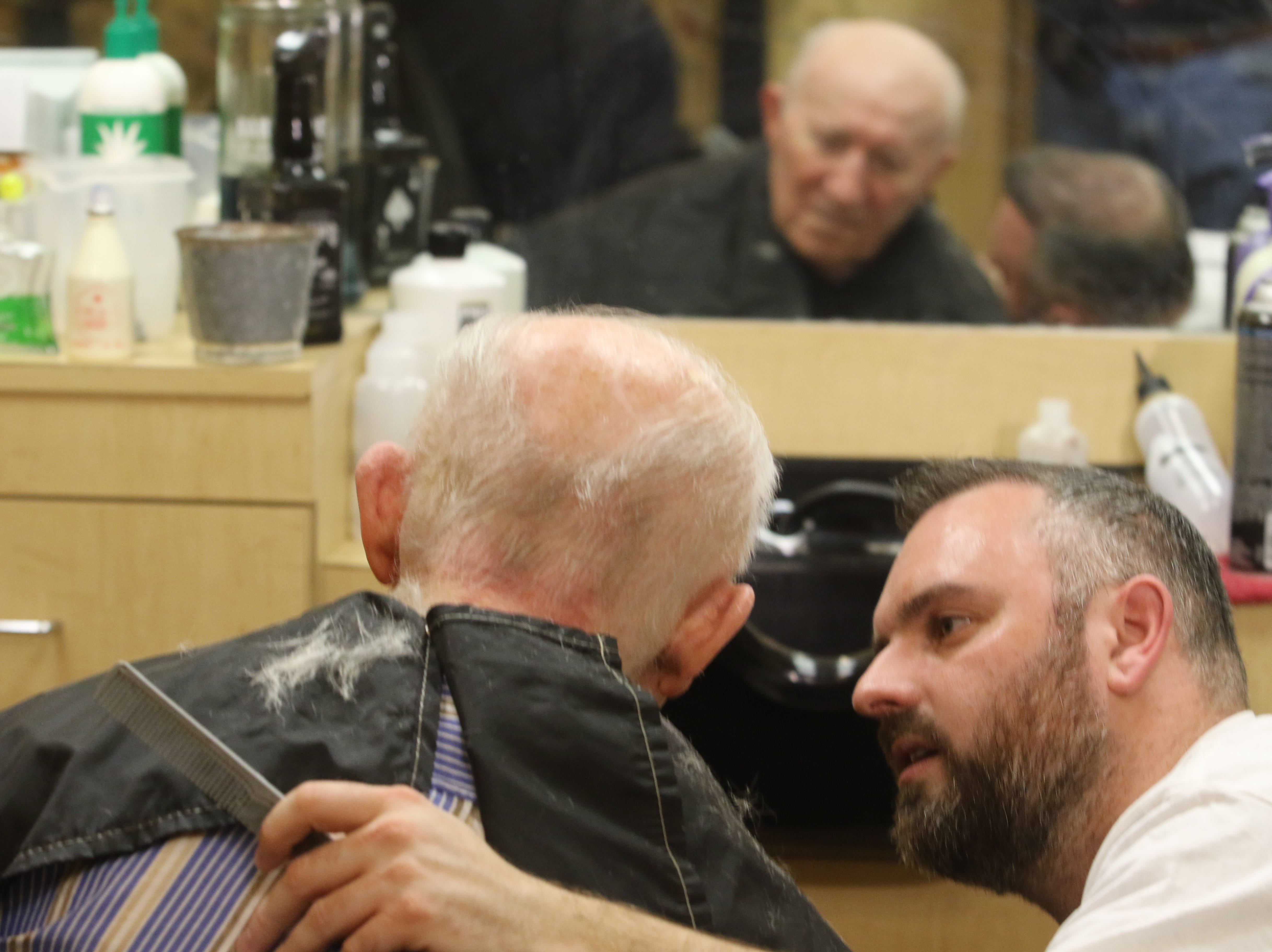 Lenny White, a barber from Northern Ireland, spends some time talking with Constantine Soukas 83 as White gave him a complimentary haircut. Soukas is a resident of The Chelsea of Montville, an assisted living facility in Montville Twp., NJ on January 3, 2019.