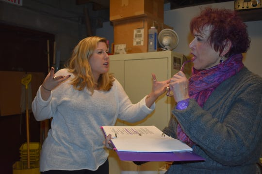 "Jessica Phelan, left, and Roseann Ruggiero rehearse a scene from ""Perfectly Compliant."""