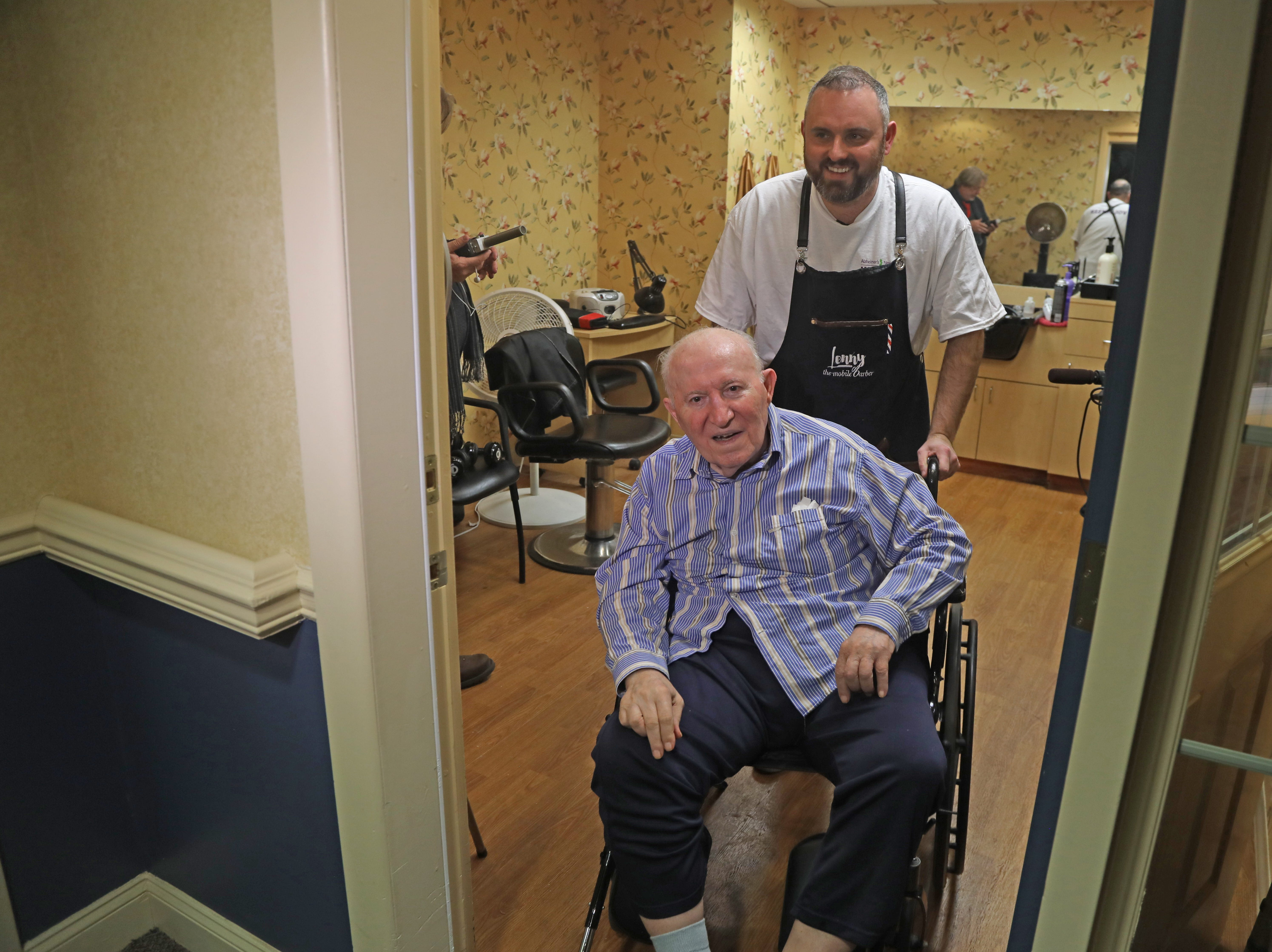 Lenny White, a barber from Northern Ireland, after giving a complimentary haircut to Constantine Soukas 83.  Soukas is a resident of The Chelsea of Montville, an assisted living facility in Montville Twp., NJ on January 3, 2019.