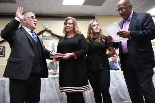 (from left) Robert Robbins is sworn in to the Bogota Borough Council as his wife Terri and daughter Emily look on. Assemblyman Gordon Johnson administers the oath of office on Thursday, January 3, 2019.