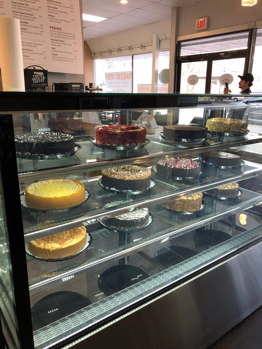 Mara's Cafe & Bakery's beloved cakes sit in the display.