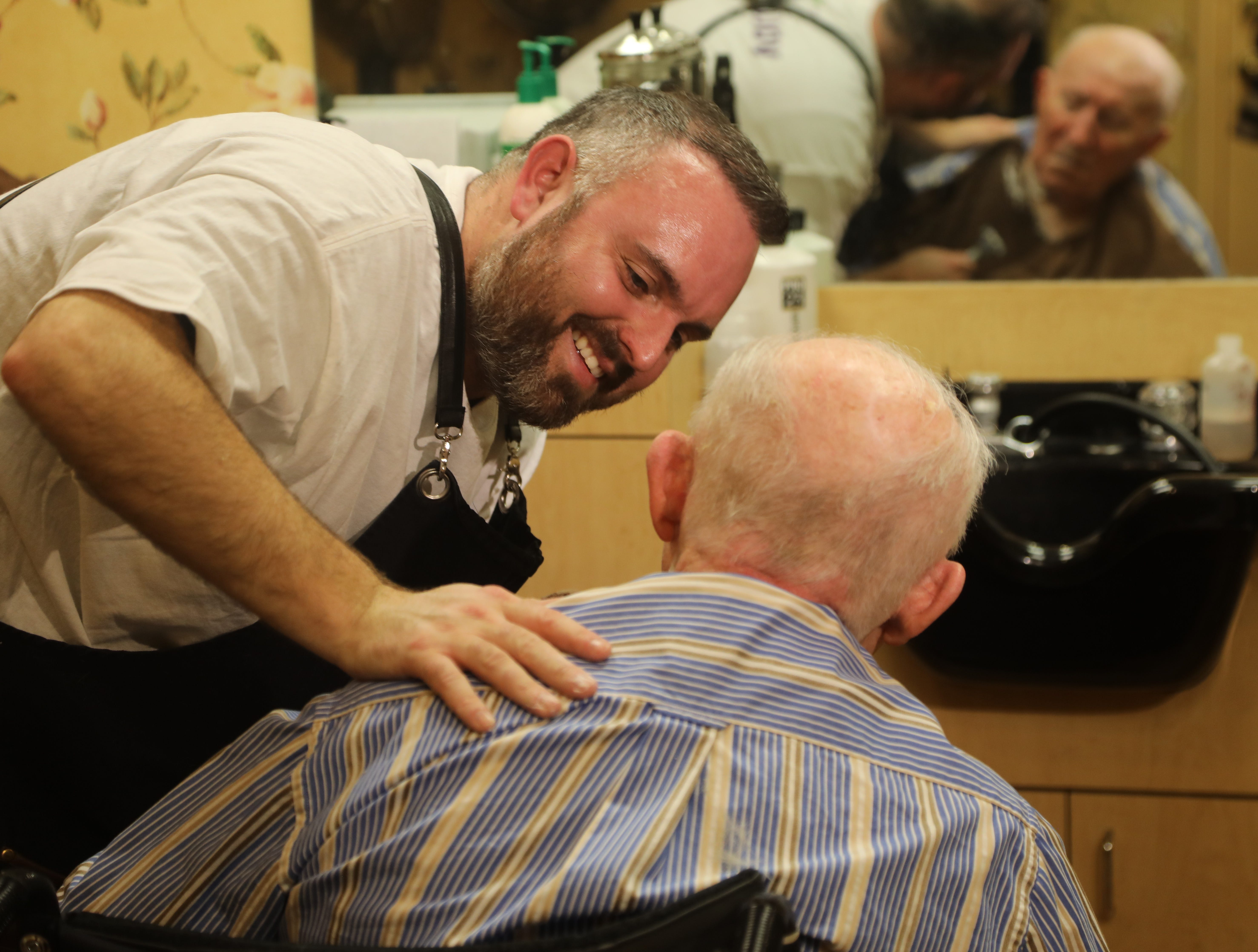 Lenny White, a barber from Northern Ireland, finishes giving a complimentary haircut to Constantine Soukas 83.  Soukas is a resident of The Chelsea of Montville, an assisted living facility in Montville Twp., NJ on January 3, 2019.