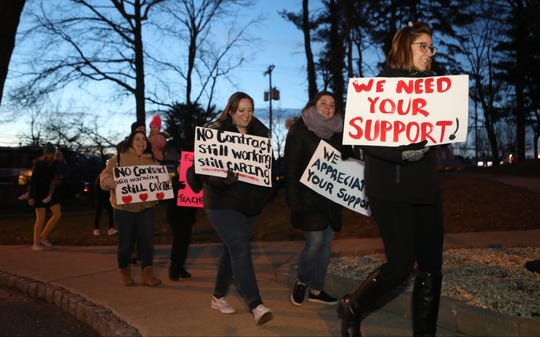 Hundreds gathered outside the Dr. Frank A. Calabria Education Center in Parsippany to protest the fact that teachers are working without a contract. Thursday, January 3,  2019