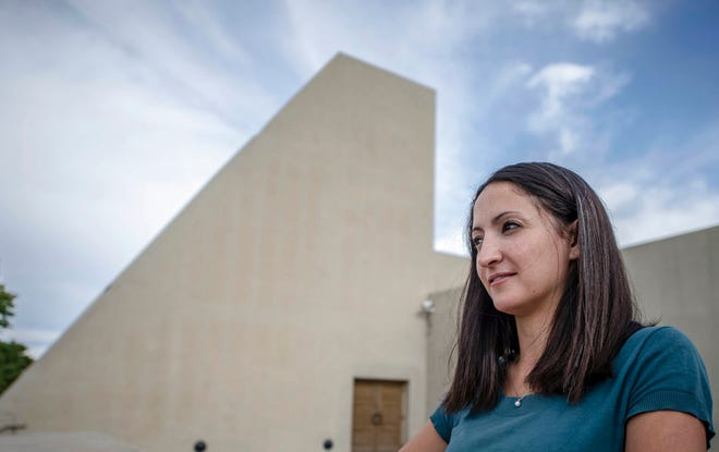 In this May 29, 2014 photo, Rebecca Avitia, executive director of the National Hispanic Cultural Center, poses in Albuquerque. Avitia, who is credited with turning around the long-struggling center, was told to resign after Thanksgiving. The new administration declined her offer to stay until a new leader was selected, Avitia said.