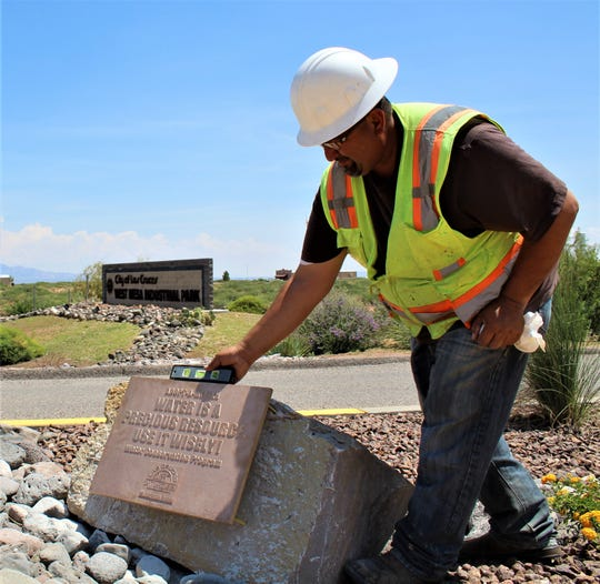 Joey Angelo, project manager for Sandoval Construction Inc., places the new LCU water conservation message at the gateway to the WMIP.