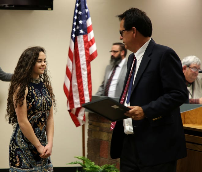 Chevel Shepherd prepares to accept a Chevel Shepherd Week proclamation Thursday from San Juan County Commissioner Jack Fornter.