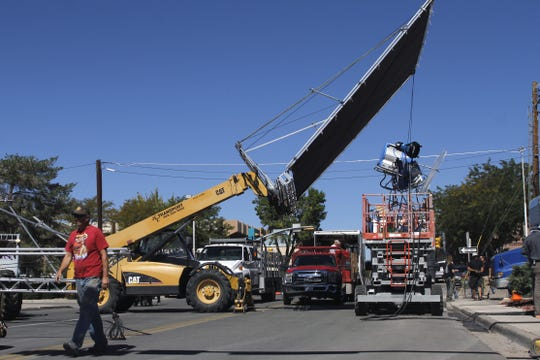 """Film crew members work on the set, Tuesday, Oct. 1, 2013, for the movie, """"Beyond the Reach"""" along South Auburn Avenue in Farmington."""