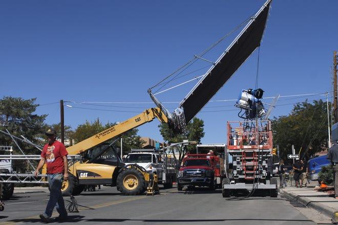 "Film crew members work on the set of the movie, The Reach"" along South Auburn Avenue in Farmington on Oct. 1, 2013."