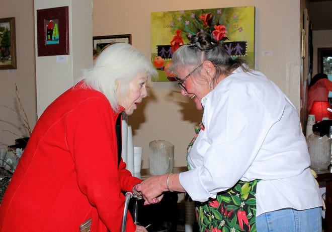 Tina Greene welcomes a visitor to her Cafe as a mutual smile and open arms were shared between the two.
