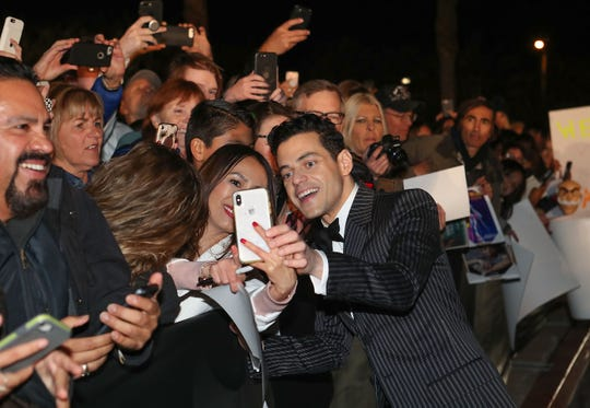 Rami Malek signs autographs for fans at the Palm Springs International Film Festival Awards Gala, January 3, 2019.