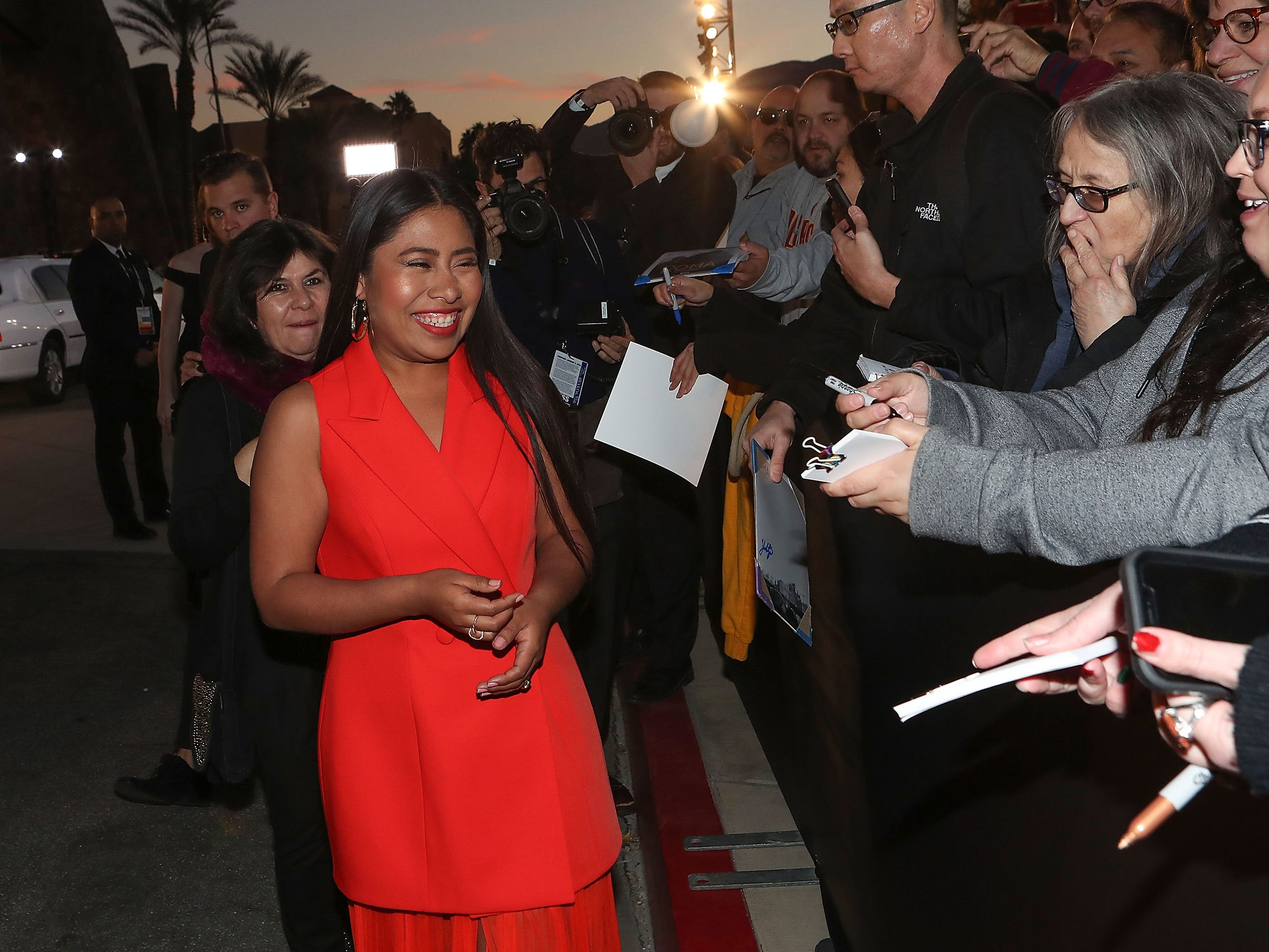 Yalitza Aparicio signs autographs for fans at the Palm Springs International Film Festival Awards Gala, January 3, 2019.